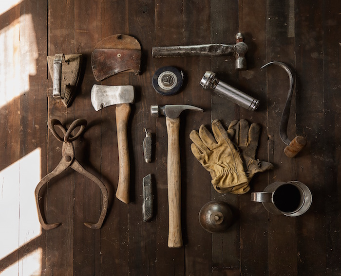 Image of Tools Arranged on Wood Floor